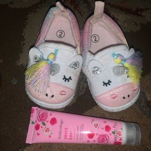 Nwot size 2( baby girl) and lotion..